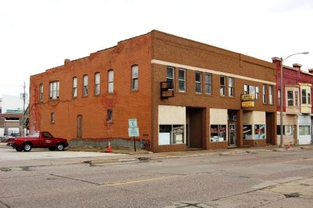 Two story two part commercial building with replacement facade